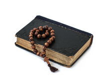 Rosary on the Bible isolated on a white background Stock Images