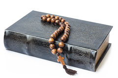Rosary on the Bible isolated on a white background. Royalty Free Stock Photography