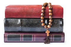 Rosary on the Bible isolated on a white background. Stock Photography