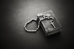 Rosary on the Bible Royalty Free Stock Photography