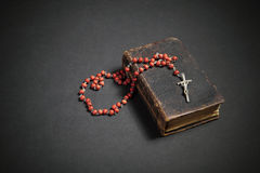 Rosary on the Bible Stock Photography