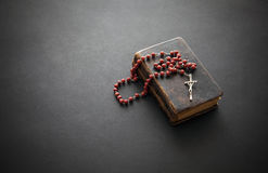 Rosary on the Bible Stock Image