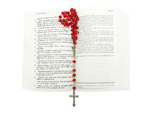 Rosary and bible on white Stock Photos