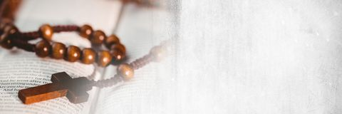 Rosary on bible and white grunge transition Royalty Free Stock Images