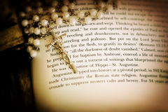 Rosary on book Stock Image