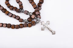 Rosary with a cross on white background Royalty Free Stock Photography
