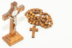 Rosary and Cross. Wooden rosary and cross on white background Royalty Free Stock Photos