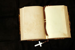 Rosary and empty pages book. Old 19th century book with middle pages blank and rosary stock photography
