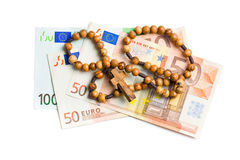 Rosary with euro bills Royalty Free Stock Image