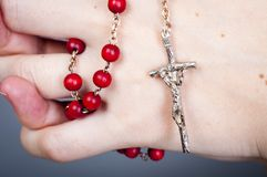 Rosary with female hand. An image of rosary on female hand Royalty Free Stock Image