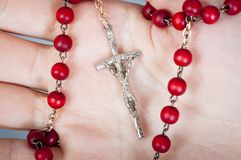 Rosary with female hand. An image of rosary on female hand Stock Photography