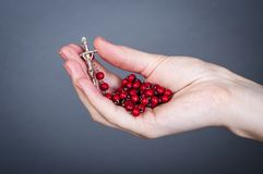 Rosary with female hand. An image of rosary on female hand Stock Photo