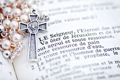 Rosary and French Bible Stock Image