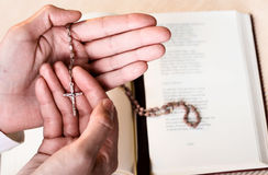 Rosary in hand Royalty Free Stock Image