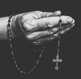 Rosary in hand. Of senior. Black and white photography Royalty Free Stock Photo