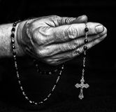Rosary in hand. Of senior. Black and white photography Royalty Free Stock Photos