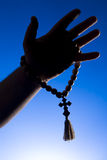 Rosary in hand Royalty Free Stock Images