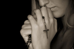 Rosary in hands Royalty Free Stock Image
