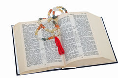 Rosary and a holy bible. Nephritic rosary over an holy bible Stock Image
