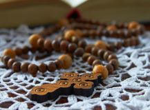 Rosary with holy bible Stock Images