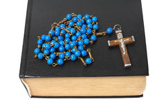 Rosary and holy bible Stock Photos