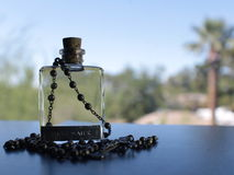 Rosary and Holy Water Royalty Free Stock Images