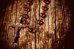 Rosary inon wood Stock Photos