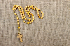 Rosary on jute background Stock Photography