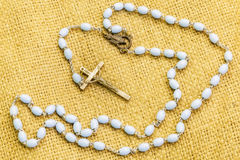 Rosary on jute fabric Stock Photography