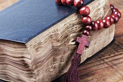 rosary lying on a closed Bible Stock Photography