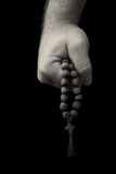 Rosary in male hands. stock photo