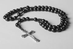Rosary on a monophonic background. Black and white photography. Stock Photo