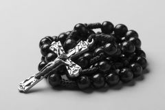 Rosary on a monophonic background. Black and white photography. Royalty Free Stock Photography