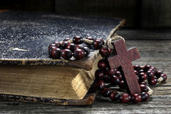 Rosary and old book Royalty Free Stock Images