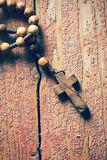 Rosary on old wooden table Stock Images