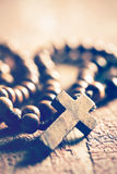 Rosary on old wooden table Stock Image