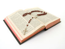 Rosary over a bible Royalty Free Stock Image