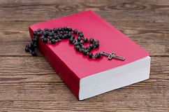 Rosary  over the Bible Royalty Free Stock Photos