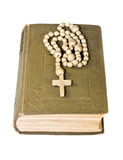 Rosary over an old holy bible Stock Photography