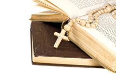 Rosary over an old holy bible Royalty Free Stock Photos
