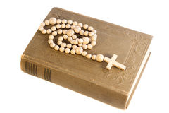 Rosary over an old holy bible Royalty Free Stock Photo