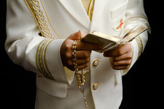 Rosary and prayer book. Boy holding a prayer book and a rosary in his First Holy Communion Royalty Free Stock Photo