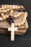 Rosary and prayer book Stock Images