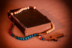 Rosary and prayer book. Old prayer book and rosary. Vintage style Stock Photo