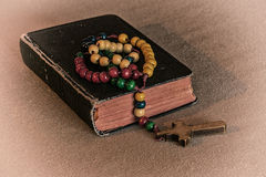 Rosary and prayer book2. Wooden rosary and prayer book. White vignette Royalty Free Stock Photo
