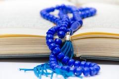 Rosary and Qoran Stock Photo