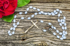 Rosary with rose Royalty Free Stock Image