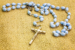 Rosary on rustic jute fabric Royalty Free Stock Photo