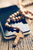 Rosary and smartphone royalty free stock images