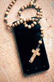 Rosary and smartphone Stock Image